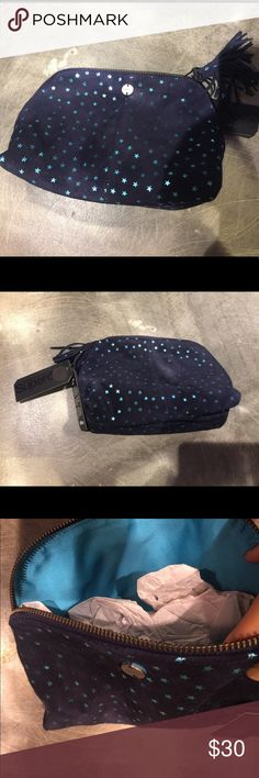 Superdry  leather makeup bag Superdry  leather makeup bag . New navy blue color leather with stars ✨ . Superdry Bags Cosmetic Bags & Cases