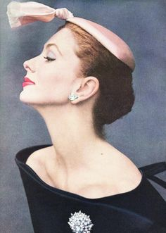"Suzy Parker wearing cocktail hat of silk satin by Balenciaga photographed by John Rawlings for ""Vogue"" October 1953."