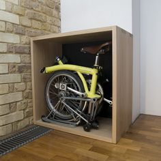 Furniture that stores (hides) a folding bike (i.e. Brompton)
