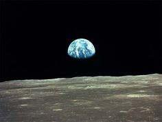 """This view of the Earth rising over the Moon's horizon was taken during the Apollo 11 mission in 1969. The lunar terrain pictured is in the area of Smyth's Sea on the nearside. While the Lunar Module """"Eagle"""" was on the surface to explore the Sea of Tranquility, the Command and Services Module """"Columbia"""" remained in lunar orbit.    Image Credit: NASA"""