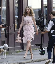 Amanda Seyfried looked gorgeous in a pretty pink dress as she shot a campaign for Givenchy's new fragrance Live Irresistible in Paris on June 23, 2016