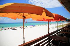 turquoise waters and orange umbrellas...perfect.