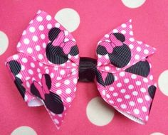 Minnie mouse hair bow. https://www.etsy.com/listing/227523578/pink-minnie-mouse-hair-bow?ref=shop_home_active_1