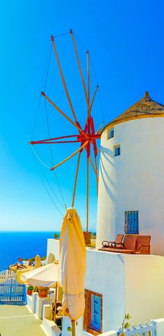 Old, traditional windmill in Oia, Greece