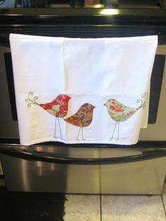 cute appliqued dishtowel with hand embroidery. I like this!