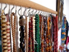 Jewelry display. Use twig or branch w/hooks to achieve the same thing w/a more natural look