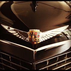 Cadillac emblem adorns the hood of a 1936 V16 Dual Cowl Sport Phaeton. Sweet