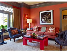 Jay Jeffers red living room Some paint colors in deep orange-red range: Sherwin-Williams---  SW881 Cayenne & SW6622 Hearty Orange. Benjamin Moore---  1307 Geranium & 2171-20 Fire Dance. Dunn Edwards  California Paints DE--- 5124 Southwestern Clay.