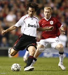 Paul Scholes (right) and Andrea Pirlo of Milan during the Champions League Semi-Final First Leg match between Manchester United and AC Milan at Old Trafford in Manchester, England.