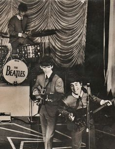 Ringo Starr, George Harrison, and John Lennon on stage - the Beatles