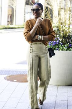 SWEATER: ZIZA BOUTIQUE(ONE SIZE FITS ALL) ON SALE FOR $18.42 | KHAKI  SAILOR PANTSON SALE FOR $69.99 PLUS 40% OFF | BAG | TORTOISESHELL  SUNGLASSES | BLACK AND GOLD RING | LEOPARD PRINT SHOES  JavaScript is currently disabled in this browser. Reactivate it to view  t