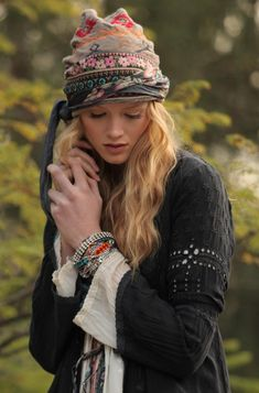 This or a Beanie/hat like this one. Any info let me know please. (it might be a separate beanie with scarfs attached, not sure)
