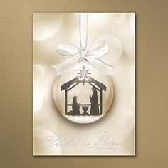 """Prince of Peace- Nothing says """"Christmas"""" like a nativity scene, and this holiday card says it beautifully. The ornament design and wording shine in silver foil.  Made from recycled paper by manufacturers using renewable energy sources."""