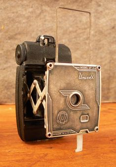 www.unocollectibles.com Very cool old box camera...glad to see these have never 'died', really...see adorama.com for all your 35 mm supplies...