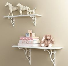 I may have to spray paint some of my Breyer horses white and do this in masyns room, I love it!