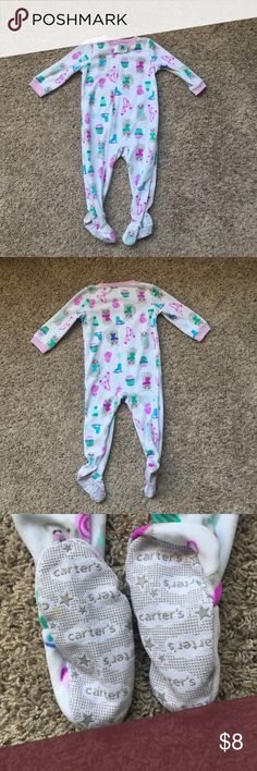 Carter's infant girl footie pajamas Like new Carter's girls fleece footie pajamas! Perfect for cozy winter nights!  Zipper closure. Cat, mitten, ice skate, and sweets design! Multi color.  No noticeable stains. Bottoms of feet slightly stained/dirty.  ***ALL USED YOUTH CLOTHING SUBJECT TO STAINS UNLESS OTHERWISE STATED*** Carter's Pajamas