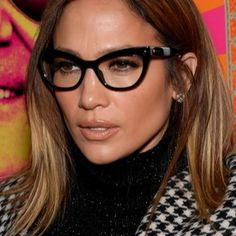 Jennifer Lopez made glasses a red carpet worthy accessory in NYC on October 19 when she wore her cat frame glasses with contoured skin a nude lip and neutral eye makeup. Get expert tips for wearing makeup with glasses like Jennifer Lopez. Fashion Eye Glasses, Cat Eye Glasses, Makeup With Glasses, How To Wear Makeup, Lunette Style, Blonde Makeup, Eyewear Trends, Cool Glasses, Glasses Frames