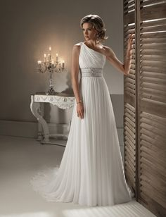 greek wedding dress.... Would look amazing against a Greek island background!