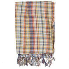 Check-Print Scarf designed by Jean Bourget. Features a mixed-color pattern and tassels.