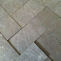 Tiles made from reclaimed laminate paper (from worktops etc)   at  www.slate-ish.com  (USA)