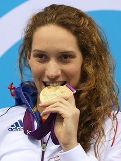 Gold medallist Camille Muffat of France poses on the podium