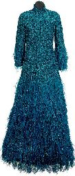 A TURQUOISE BLUE METALLIC KNIT EVENING DRESS AND OSTRICH FEATHER BOA  The long evening gown of high neck, ostrich feather and tinsel fringe trimmed cuffs and hem, layered silk faille and netted skirt with high-cut front and long flowing train, all lined in blue silk sold at Christie's in 2007 for $4,220 Maria Felix: La Dona Collection