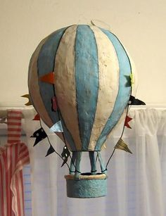 made it paper mache with tissue paper so i didn't have to paint. I'll post a pic.Blue and White Striped Hot Air Balloon It's not on this site but I'm thinking I can make it out of paper mache Paper Clay, Paper Mache Clay, Paper Art, Paper Mache Balloon, Diy Paper, Paper Mache Projects, Paper Mache Crafts, Air Ballon, Hot Air Balloon