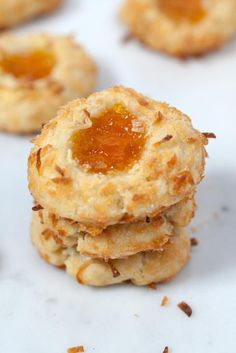 Tasty }- Coconut Thumbprint Cookies - These are basically plain buttery shortbread cookies that have been rolled in sweet coconut and topped with a dollop of really great pineapple-apricot preserves. No Bake Cookies, Yummy Cookies, Cake Cookies, Cookies Et Biscuits, Coconut Cookies, Apricot Cookies Recipe, Thumbprint Cookies Recipe, Cookie Desserts, Just Desserts