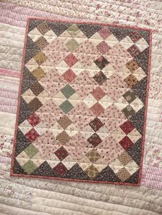 t's a doll-quilt by Kathleen Tracy, made with diagonal four-patches (like this one). The pattern comes from the book The Civil War sewing ci...