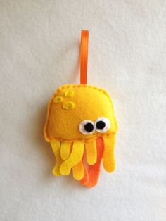 Felt Holiday Ornament  Hubert the Yellow jellyfish by RedMarionette on Etsy