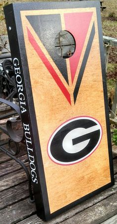 Black stained G Georgia cornhole boards game set. Tailgating bag toss.