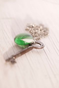 Old Skeleton Key with green glass bead