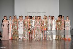 Models pose at the Piccione.Piccione show during Milan Fashion Week Spring/Summer 2018 on September 24, 2017 in Milan, Italy.
