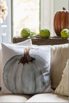It's that time of year again! Time to break out the gorgeous pumpkin watercolor pillow for fall! Who else is ready for cooler temps and autumn decor??