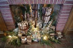 Beautiful display in an unused fireplace. Birch logs bundled w/ leather belts, glass canisters filled w/ ornaments, evergreen branches tucked in for color / fragrance, & a battery operated light strand. Noel Christmas, Merry Little Christmas, Christmas Is Coming, Rustic Christmas, All Things Christmas, Christmas Crafts, Christmas Decorations, Christmas Ideas, Tartan Christmas