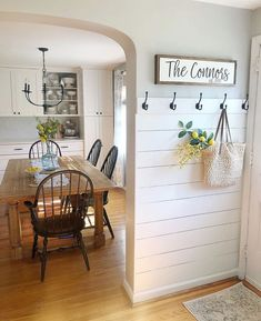 beautiful foyer entryway and diningroom with built ins. shiplap and open shelving great farmhouse style