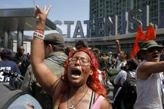 An Occupy Wall Street activist shouts slogans while she takes part in a march in downtown Manhattan in New York