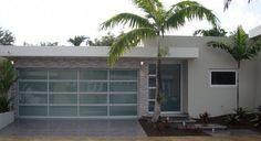 Puertas de Garaje Puerto Rico | Garage Doors PR | Casas - Puertas de Garaje - Tu Ventana. Get the look with the Clopay Avante Collection aluminum door with frosted glass panels. www.clopaydoor.com.