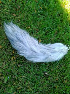 20 inch long, 5 inch wide grey wolf yarn tails! These wolf tails are created using multiple colors, usually up to 6 or 7 different dye lots to