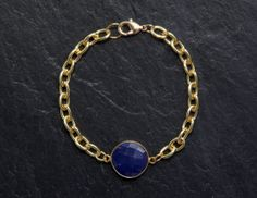 Sapphire bezel and gold plated chain bracelet by rosehipjewelry, $40.00