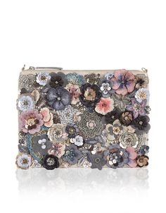 A masterpiece of beadwork and embroidery, our Posey zip top bag gives flower power a fashion-forward feel. Style with complementary neutral hues to let this ...