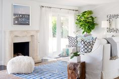 Beach Style Living Room-  white paint with a hint of gray for the walls,  vibrant white paint for the baseboards and cabinets
