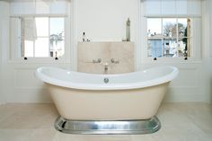 Acrylic painted Excelsior bath with aluminium plinth from www.bcdesigns.co.uk bathroom design by Greenleaf Lighting