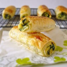 Feta Ricotta and Spinach Roll. Ingredients: frozen spinach, reduced fat feta, fresh ricotta, puff pastry, salt and pepper, egg yolk for egg wash