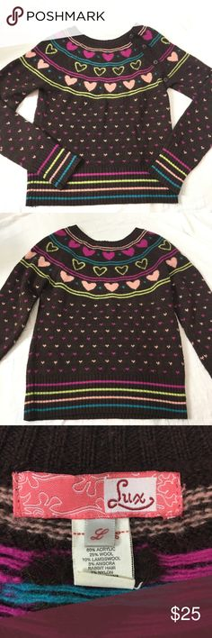 "Urban Outfitters Lux Retro crew neck heart sweater This is by the brand ""Lux"" sold at Urban Outfitters. A super retro vintage looking sweater reminiscent of the 80s. Chocolate brown with pink, fuchsia, and lime green hearts and stripes. Four buttons along the left shoulder. Super soft blend of acrylic, wool, lambs wool, and angora rabbit hair. Does show some signs of wear/pilling but no stains, tears, or holes. See photos for measurements. Urban Outfitters Sweaters Crew & Scoop Necks"
