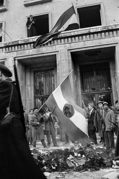 LEST WE FORGET Erich Lessing: Budapest, October © Erich Lessing/Magnum Photos The Hungarian Uprising- The Russian Communist emblem cut out of the Hungarian flag Hungarian Flag, Forget, Magnum Photos, Budapest Hungary, Cold War, Countries Of The World, Old Pictures, Historical Photos, World War Ii