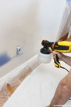 Wondering how to use a paint sprayer to paint walls? Use a FLEXIO paint sprayer to paint interior walls even faster! That pre-taped masking film stops paint from getting everywhere - genius especially for painting right near the trim! Best Paint Sprayer, Using A Paint Sprayer, Interior Paint Sprayer, Wagner Paint Sprayer, Spray Paint Furniture, Painting Trim, Spray Painting, House Painting, Spray Paint Wall