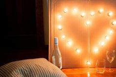 Make your own custom marquee out of cardboard and bistro lights!