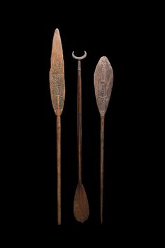 Here is a set of three nice older Oceanic canoe paddles. The left is a well-used paddle from Lake Sentani with the classic curvilinear pattern carved in relief. The middle one comes from Santa Cruz Island, Solomon Islands and has an elegant handle. The right paddle is a rare example from Humboldt Bay, north coast of New Guinea with a nice design of stylized birds carved in relief. All three date to the early/mid 20th century