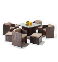 The fabulous Montana four seater Rattan Garden Furniture Set. This set is made from synthetic Rattan which has been specially treated to dramatically reduce fading. You can happily leave this furniture outside all year. The furniture is maintenance free, and simly wipes clean with a damp sponge.  The Montana 4 Seater Cube Set consists of a square table with a glass top, 4 chairs and 4 footstools which all come with cushions.